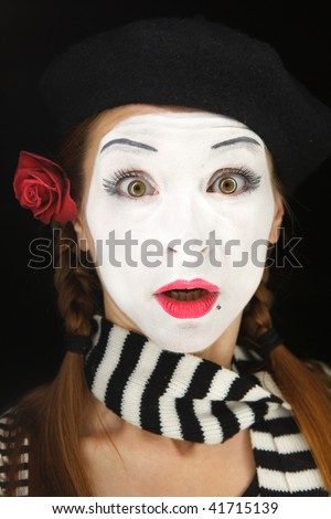 Mime portrait with surprised face expression isolated over black background