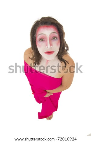 Mime with pink and white make up looking into the camera on  a white background