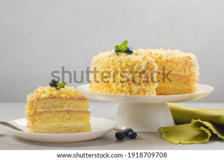 Mimosa cake - traditional Italian sponge cake for celebration of the 8th ofMarch, International  Women's Day.  Horizontal image, light background.