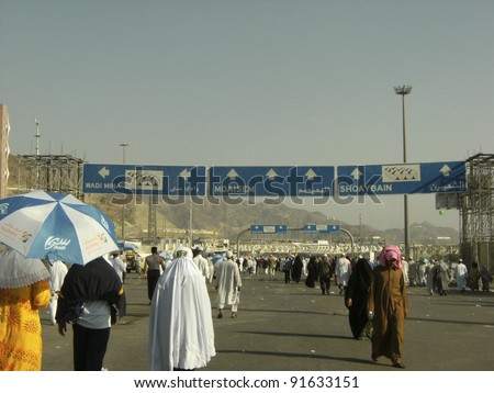 MINA, SAUDI ARABIA - DEC 22 :Muslim pilgrims walk outside Muaisem tunnel on Dec 22, 2007 in Mina, Saudi Arabia. Millions of muslims around the world perform hajj during this time.