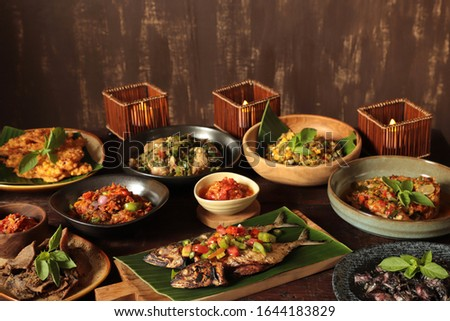 Minahasan Risjttafel. An array of traditional Minahasan dishes served in upscale style. Photo stock ©