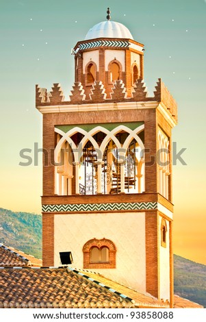 Minaret of a traditional moorish mosque in Spain at dusk