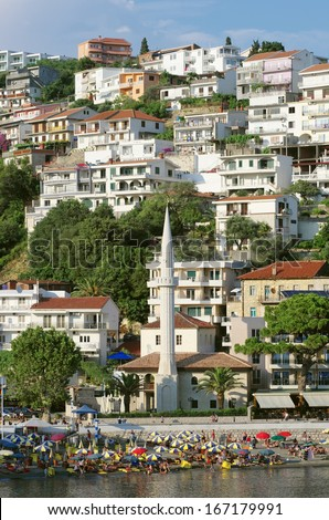 "minaret of the mosque on the crowded ""Mala Plaza"" beach in Ulcinj downtown, Montenegro"