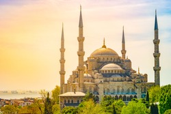 Minarets and domes of Blue Mosque with Bosporus and Marmara sea in background, Istanbul, Turkey. Beautiful landscape at sunset.