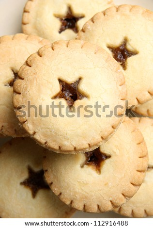 Mince pies stacked on a plate
