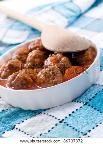 Minced meat ball in tomato sauce. Selective focus