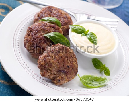 Minced meat ball with sauce on plate. Selective focus