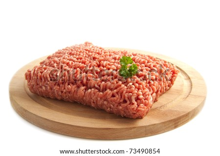 Minced meat on a wooden plate isolated over white