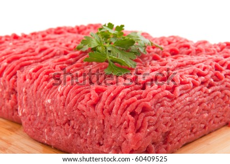 Minced meat with parsley isolated over white