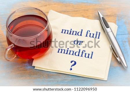 Mind full or mindful   Inspiraitonal handwriting on a napkin with a cup of tea. #1122096950