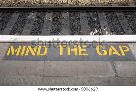 Mind the gap sign on a British railway platform.