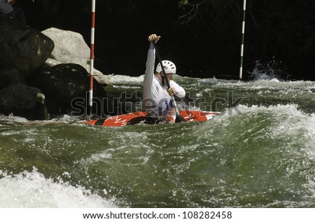 MINDEN - JULY 21: An unidentified contestant competes at Ontario Summer Race on July 21, 2012 at Gull River in Minden, Ontario, Canada. This is also the venue for 2015 Pan Am canoe/kayak slalom race.