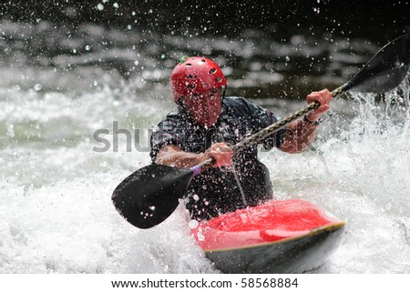 MINDEN, ONTARIO - AUGUST 1: An unidentified contestant competes at Canadian Whitewater Slalom National Championship on August 1, 2010 at Gull River in Minden, Ontario, Canada.