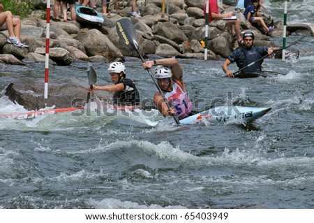 MINDEN, ONTARIO - AUGUST 1: Three unidentified contestants in kayak during the Canadian Whitewater Slalom National Championship on August 1, 2010 at Gull River in Minden, Ontario, Canada.