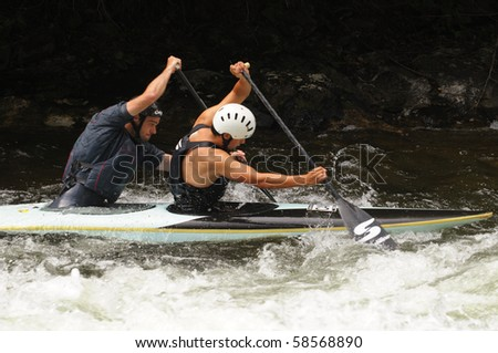 MINDEN, ONTARIO - AUGUST 1: Two unidentified contestants compete at Canadian Whitewater Slalom National Championship on August 1, 2010 at Gull River in Minden, Ontario, Canada.