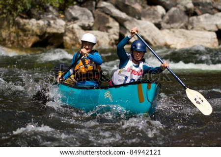 MINDEN, ONTARIO - SEPT 10.  Two unidentified contestants compete at Open Canoe Slalom Race, 2011 at Gull River in Minden, Ontario, Canada. Sept. 10, 2011