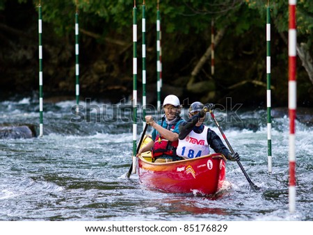 MINDEN, ONTARIO - SEPT 10: Two unidentified contestants compete at Open Canoe Slalom Race, 2011 at Gull River in Minden, Ontario, Canada.