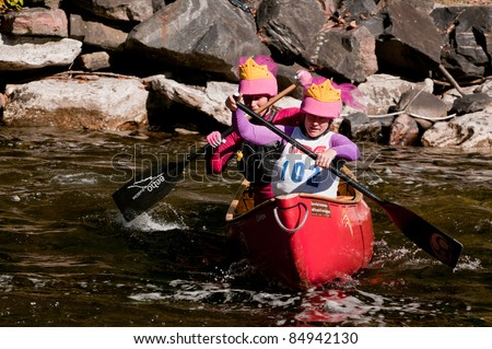 MINDEN, ONTARIO - SEPT 10. Two unidentified female contestants compete at Open Canoe Slalom Race, on September 10, 2011 at Gull River in Minden, Ontario, Canada. Sept. 10, 2011