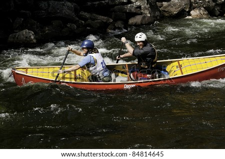MINDEN, ONTARIO - SEPT. 10: Unidentified mixed pair competes at Open Canoe Slalom Race, 2011 at Gull River on September 10, 2011 in Minden, Ontario, Canada.