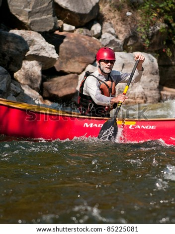 MINDEN, ONTARIO - SEPTEMBER 10: An unidentified contestant competes at 2011 Open Canoe Slalom Race at Gull River in Minden, Ontario, Canada on September, 10, 2011.