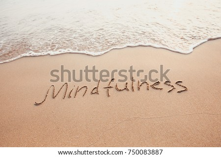 mindfulness concept, mindful living, text written on the sand of beach #750083887