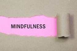 Mindfulness word written under torn paper
