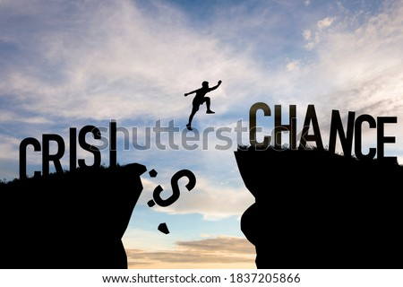 Mindset concept ,Silhouette man jumping from crisis to chance  wording on cliff with cloud sky. Stock fotó ©