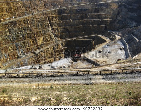 Mine gold and silver with machinery working at the base