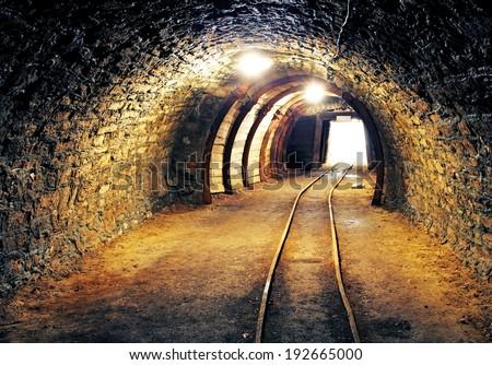 Mine underground tunnel with railroad