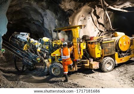 Miner climbing on a mineral mining machine