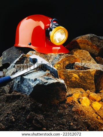 stock-photo-miner-s-helmet-with-pick-axe