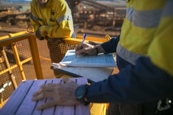 Miner supervisor review and sign of approval working at heights permit document prior to performing high risk work on construction plant mine site, Perth, Australia