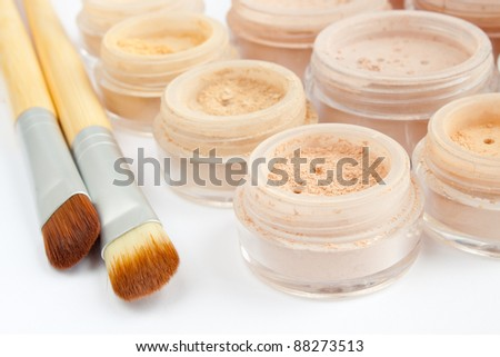 mineral make-up in containers, powder, blush, eye shadows, brushes