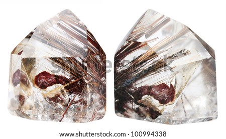 Mineral quartz with rutile it is isolated on a white background