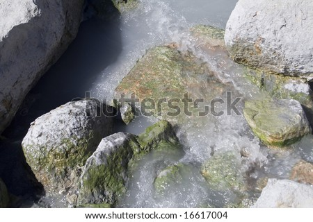 Mineral rich runoff from volcanic hot springs flowing over rocks in Lassen Volcanic National Park
