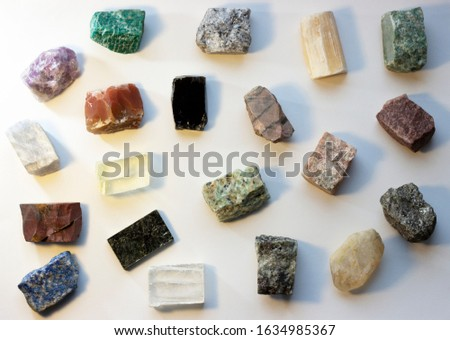 Mineral stones on white background. The concept of meditation, occultism.