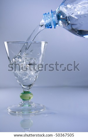 stock-photo-mineral-water-being-poured-into-a-glass-50367505.jpg