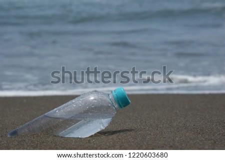 mineral water bottle in beach #1220603680