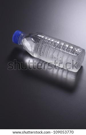 mineral water bottle on the dark background