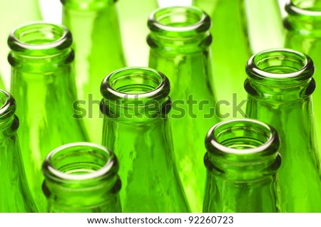 Mineral water bottles. Detail of a group of empty green bottles.