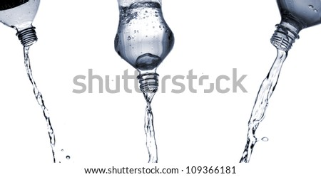 Mineral water splashes from plastic bottle isolated on white background