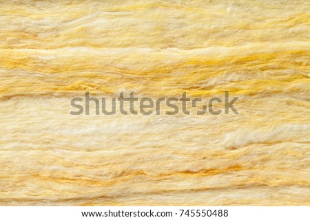 Mineral wool (or mineral fiber, mineral cotton, mineral fibre, glass wool, MMMF, MMVF) fiber thermal insulation textured background