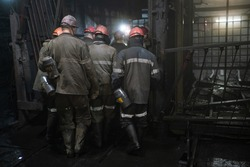 Miners in an underground mine. Coal industry