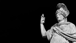 Minerva or Athena as Goddess Roma, a 19th century neoclassical old marble statue in Rome People's Square (Black and White with copy space)