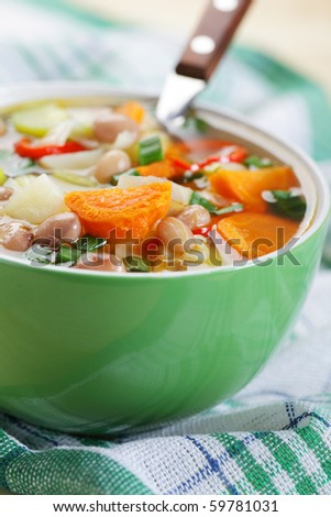 Minestrone in green bowl closeup