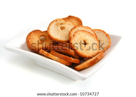 mini baked bread chips in square bowl