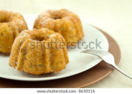 Mini Banana Bundt Cakes on a Plate with Charger and Fork