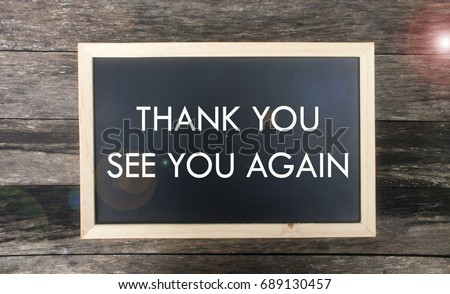 mini blackboard with text thank you and see you again isolated on wooden background
