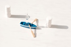 mini boat carrying ampoule on white background. Transportation and delivery of medicines