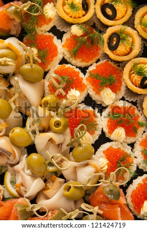 mini canape with different fish for holiday